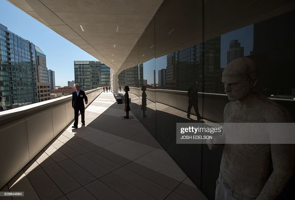 A man walks along a terrace on the 7th floor of the San Francisco Museum of Modern Art (SFMOMA) in San Francisco, California on April 28, 2016. The newly redesigned museum integrates a 10-story expansion in a new building and will open to the public on May 14, 2016. / AFP / Josh Edelson / RESTRICTED