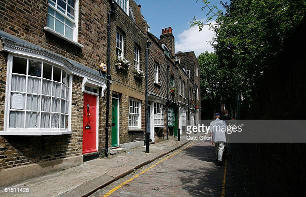 A man walks along Little Green Street in Kentish Town on June 10 2008 in north London England The small cobbled street of terraced houses built in...