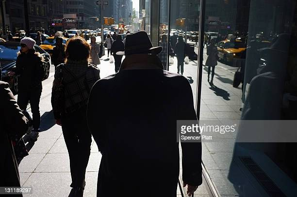 A man walks along Madison Avenue one of Manhattan's premier shopping and residential streets on November 1 2011 in New York City According to a new...