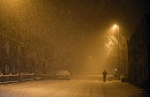 A man walks along the A62 during a heavy snow shower in Oldham northern England on January 17 2015 AFP PHOTO / OLI SCARFF