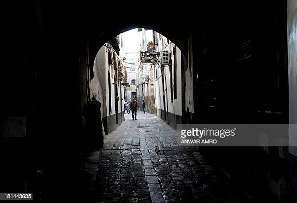 A man walks along the cobbled street in old Damascus on September 21 2013 Syria has handed over complete data on its chemical arsenal to the world's...