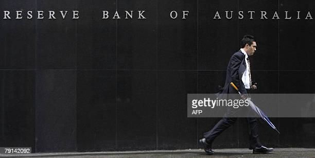 A man walks along the Reserve Bank of Australia at Sydney 21 January 2008 Boom in Asia and bust in the United States are buffeting Australia's...