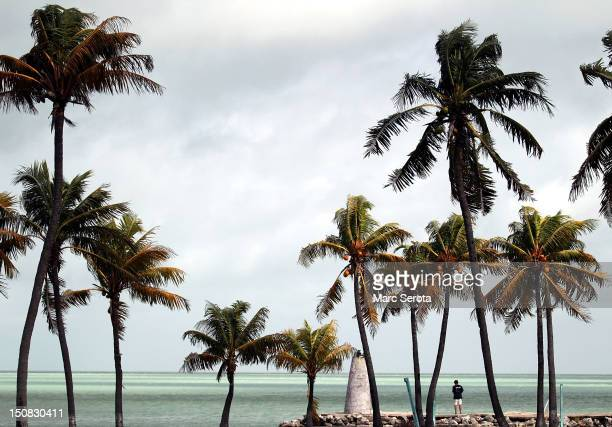 A man walks along the shore line after Tropical Storm Isaac moved through the Florida Keys on August 27 2012 in Key West Florida Isaac still rated as...