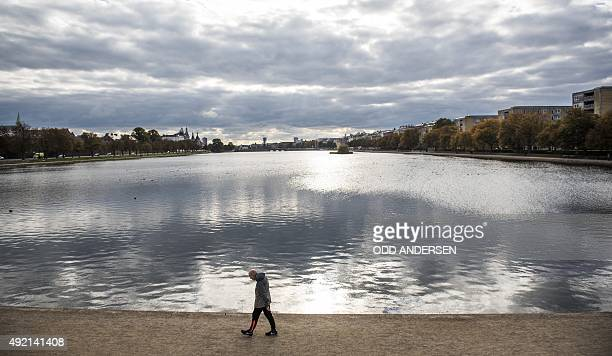 A man walks along the Sorted lake in central Copenhagen on October 10 2015The three rectangular lakes curving around the west side of the city centre...