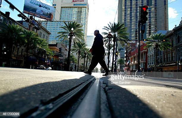A man walks along the Street Car line on Canal Street as temperatures in the area plummeted below freezing on January 7 2014 in New Orleans Louisiana...