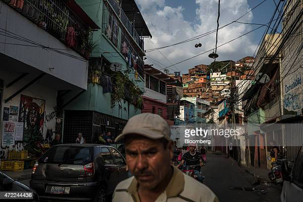 A man walks along the street in the in the Petare neighborhood home to many Colombian immigrants on the outskirts of Caracas Venezuela on Tuesday...
