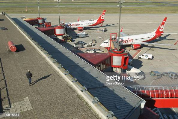 A man walks along the visitors' terrace next to Air Berlin passenger planes at Tegel Airport on October 17 2011 in Berlin Germany Tegel which first...