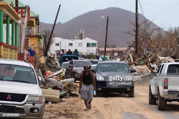 A man walks among damage on September 7 2017 in the Grand Case area on the French Carribean island of SaintMartin after the passage of Hurricane Irma...
