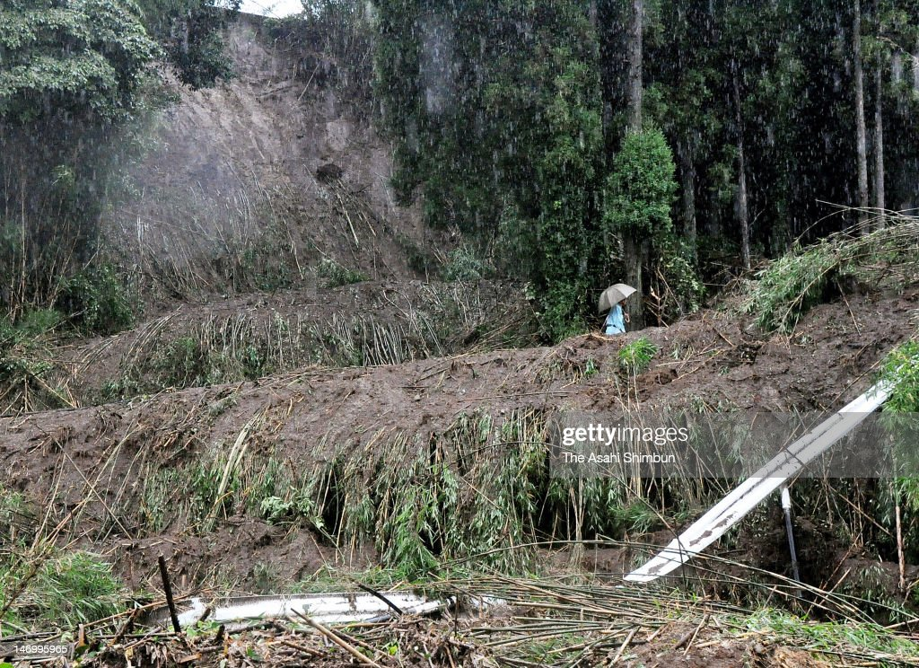 A man walks at a landslide site due to the heavy rain on June 24, 2012 in Kumamoto, Japan. 300 milimeters of rainfall in 24 hours were recorded in various places because of the rain front remains over Kyushu Island, causes landslides and evacuation advisory.