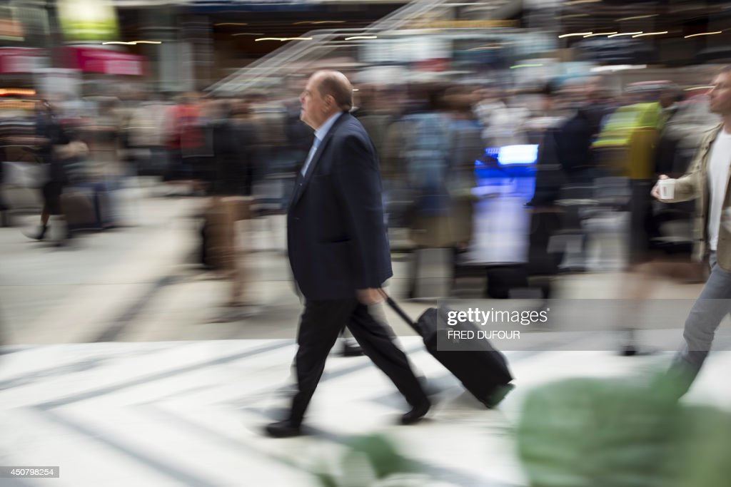 A man walks at Gare du Nord train station in Paris on June 18 during a national strike by French SNCF railway company employees Tensions rose in...