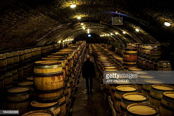A man walks at the Faiveley wine cellar in NuitsSaintGeorges during the harvest period on October 7 2013 AFP PHOTO / JEFF PACHOUD