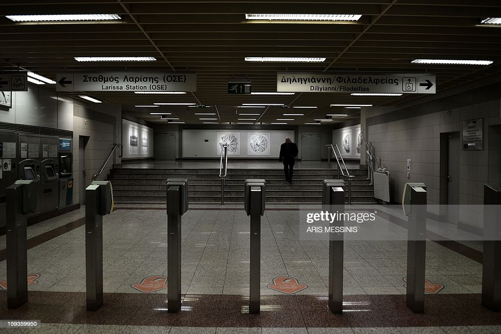 A man walks at the main Athens' metro station on January 11, 2013. AFP PHOTO / ARIS MESSINIS