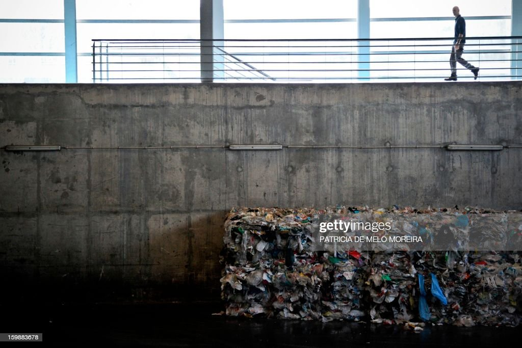 A man walks at Valorsul, a waste treatment plant, in Lisbon on January 22, 2013.