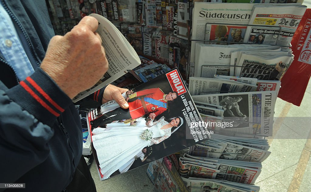 A man walks away after buying a copy of Spanish magazine Hola showing an image of the marriage of their Royal Highnesses Prince William, Duke of Cambridge and Catherine, Duchess of Cambridge following their wedding the day before, at a newsstand on May 2, 2011 in Madrid, Spain.