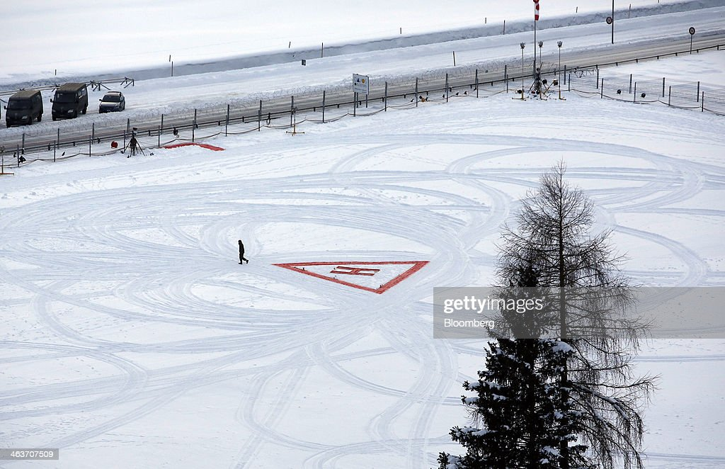 A man walks away from the helicopter landing zone marked out at the InterContinental hotel Davos, operated by InterContinental Hotels Group Plc (IHG) in Davos, Switzerland, on Saturday, Jan. 18, 2014. Next week the business elite will gather in the Swiss Alps for the 44th annual meeting of the World Economic Forum (WEF) in Davos for the five day event which runs from Jan. 22-25. Photographer: Simon Dawson/Bloomberg via Getty Images
