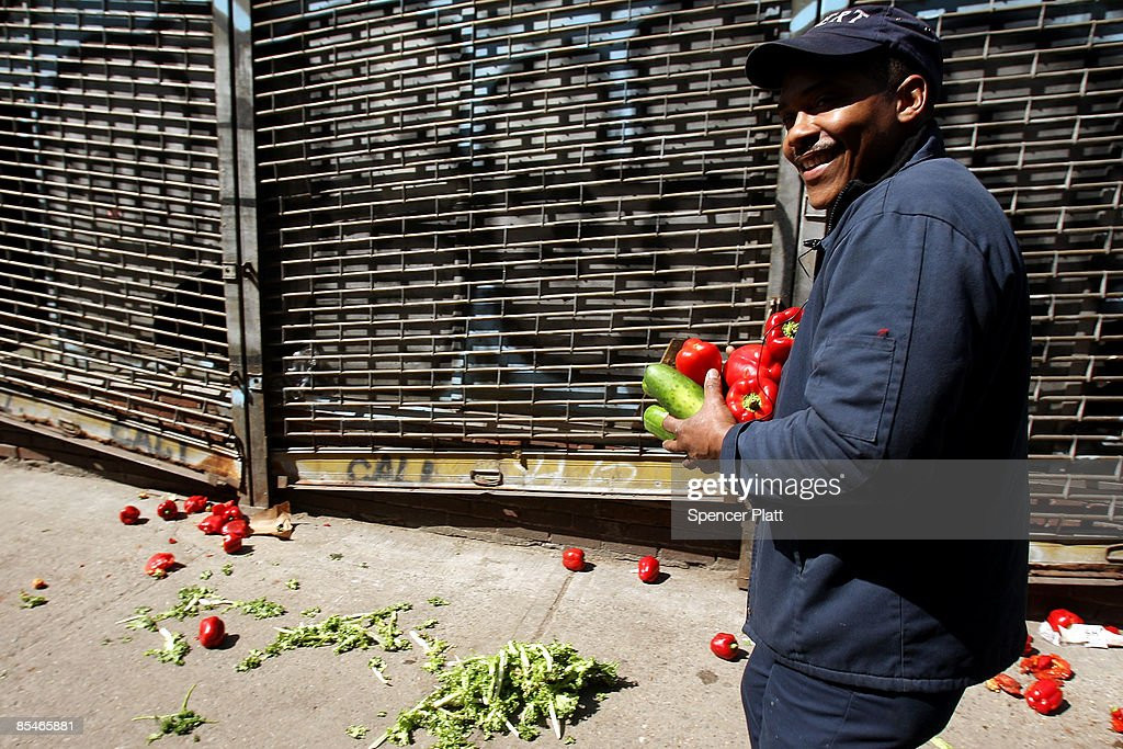 A man walks away with produce salvaged from the trash March 17, 2009 in New York City. The Labor Department reported Tuesday a big decline in food prices. Food costs have now fallen for three straight months, declining 1.6 percent in February, the biggest one-month decline in three years.