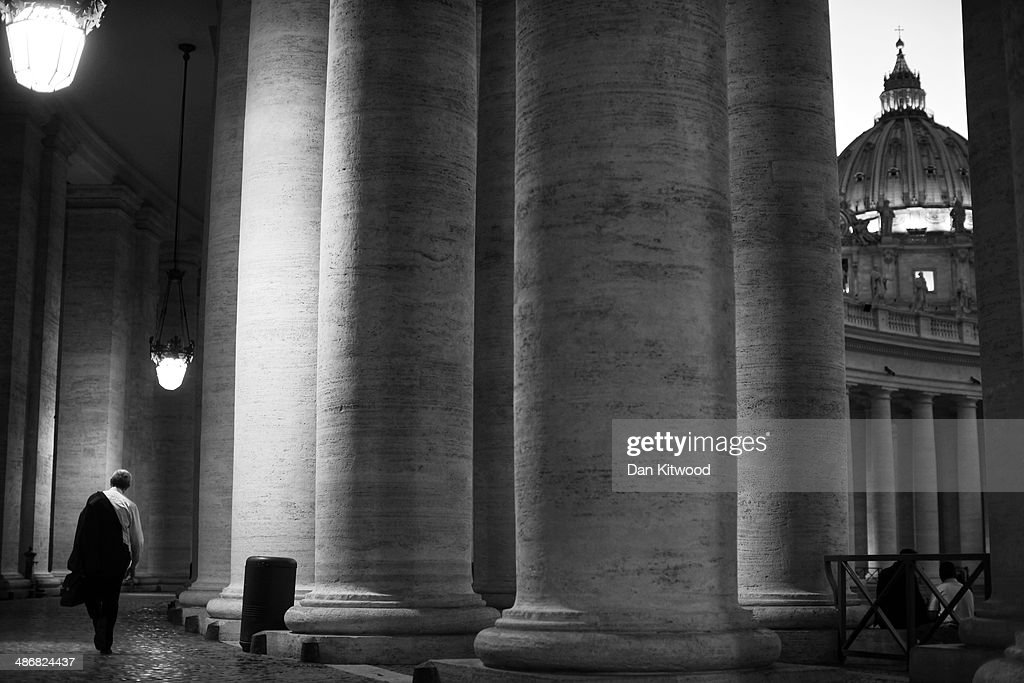 A man walks beneath the Colonnade on April 24, 2014 in Vatican City, Vatican. Dignitaries, heads of state and Royals, from Europe and across the World, are gathering in the Vatican ahead of tomorrow's canonisations. The late Pope John Paul II and Pope John XXIII will be canonised on Sunday 27 April, inside the Vatican when 800,000 pilgrims from around the world are expected to attend.