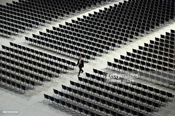 A man walks between empty seats ahead the shareholders meeting of the German engineering giant Siemens in the Olympic hall in Munich southern Germany...