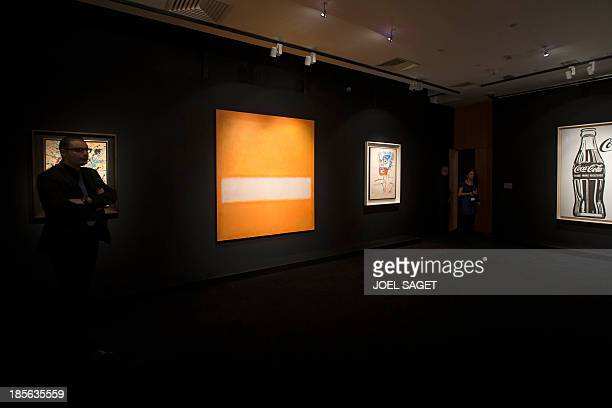 A man walks by a 1957 'Untitled' by Mark Rothko displayed on October 23 2013 at the Christie's auction house in Paris and will be auctioned in...
