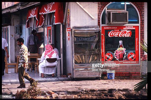 A man walks by a cafe July 15 1996 in Jeddah Saudi Arabia Possessing twentyfive percent of the world's oil reserves and the Islamic shrines of Mecca...