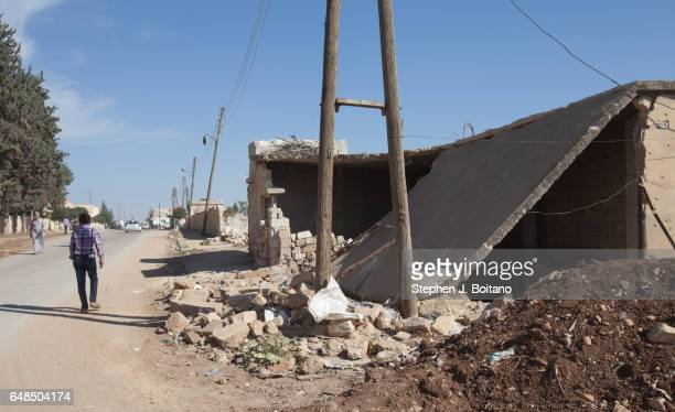A'ZAZ ALEPPO SYRIA A man walks by a destroyed home after a MIG bombing raid in A'zaz Syria