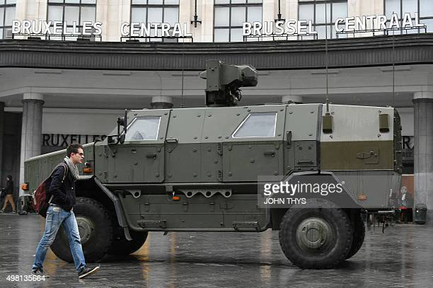 A man walks by a military vehicle parked in front of the Central Railways station in Brussels on November 21 2015 All metro train stations in...
