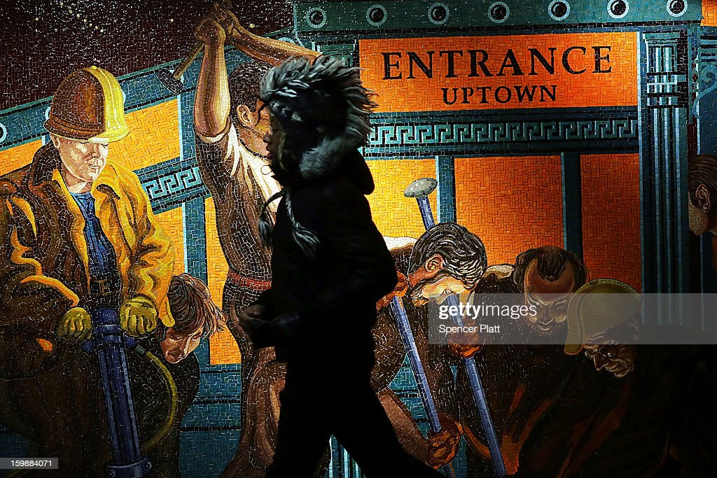 A man walks by a mural in a Times Square subway station near where a person jumped in front of a train on January 22, 2013 in New York City. New York City has been experiencing a rash of high-profile incidents involving individuals being hit by trains in suicides, accidents and people being pushed to their deaths.