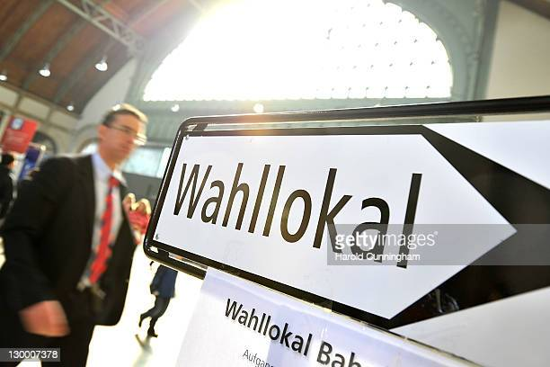 A man walks by a polling station sign in Basel main train station on October 23 2011 in Basel Switzerland According to the latest polls the farright...