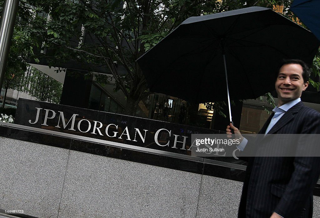 A man walks by a sign outside of the JPMorgan Chase headquarters on May 14, 2012 in New York City. Following a $2 billion trading blunder, JPMorgan Chase's chief investment officer Ina Drew retired and will be succeeded by Matt Zames, an executive from JPMorgan's investment bank. At least two others are also being held accountable for the mistake.