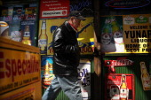 A man walks by adds in Spanish outside of a bodega on March 28 2011 in Union City New Jersey Union City New Jersey one of the state's largest cities...