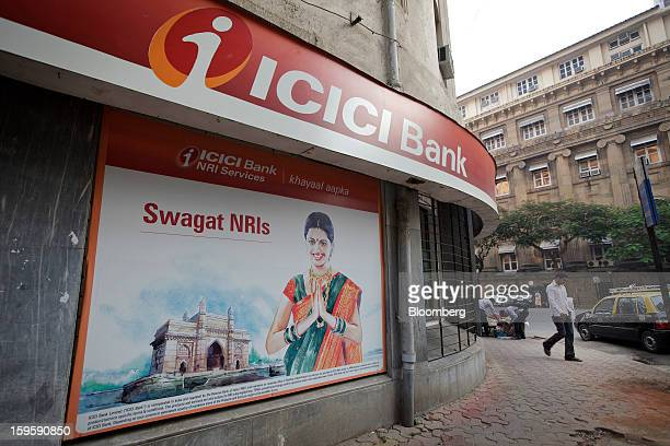 A man walks by an ICICI Bank Ltd branch in Mumbai India on Wednesday Jan 16 2013 India's financial system has been made vulnerable by a deterioration...