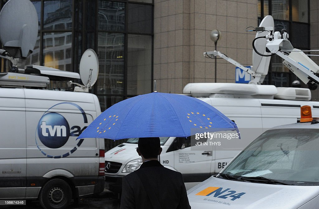 A man walks by broadcast trucks near the EU Headquarters on November 23, 2012 in Brussels, during a two-day European Union leaders summit called to agree a hotly-contested trillion-euro budget through 2020. European leaders voiced pessimism on reaching a deal on a trillion-euro EU bdget, as gruelling talks pushed into a second day with little prospect of bridging bitter divisions.