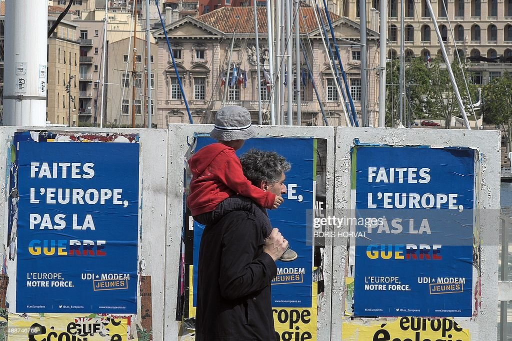 A man walks by campaign posters for the upcoming European elections, on May 8, 2014 in Marseille.
