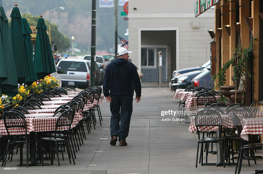 A man walks by empty tables at Cioppino's Seafood Restaurant December 3, 2008 in San Francisco, California. A report by The Institute for Supply Management says that its services sector index dropped in November to 37.3, down from 44.4 in October as the service industry struggles through the weak economy.