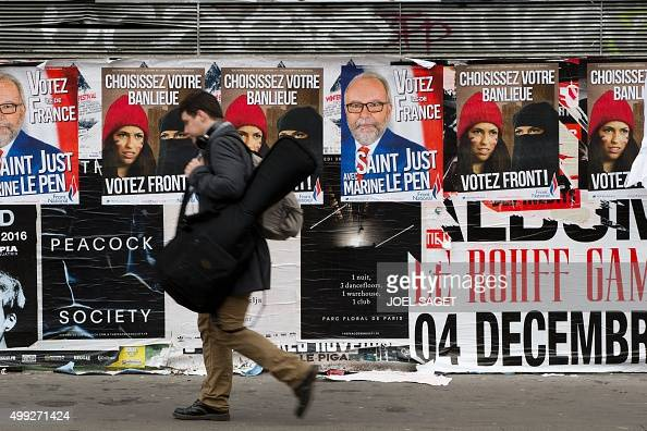 A man walks by Front National campaign posters one week ahead of the first round of the regional elections on November 30 2015 in Paris AFP...