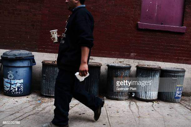 A man walks by old and neglected housing in Manhattan on November 30 2017 in New York City Republicans are coming closer to getting the votes needed...