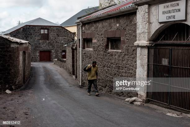 A man walks by one of the back road of Saint Helena's capital Jamestown on the British Overseas Territory of Saint Helena on October 15 2017 The...