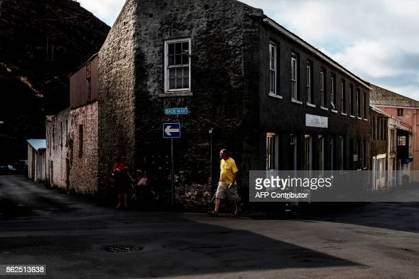 A man walks by one of the main road of Saint Helena's capital Jamestown on the British Overseas Territory of Saint Helena on October 15 2017 The...