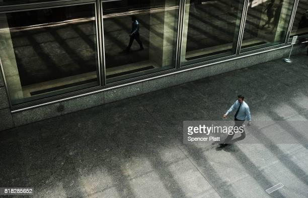A man walks by the Goldman Sach's New York headquarters on July 18 2017 in New York City Goldman Sachs Group Inc reported on Tuesday a 40 percent...