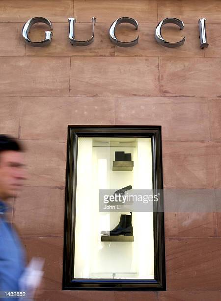 A man walks by the Gucci store outside the Bond Street store in Mayfair September 26 2002 in London United Kingdom The slump in the financial markets...