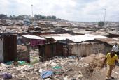 A man walks by the slum of Mathare one of the poorest slums in Nairobi on May 28 2014 Mathare is the second largest slum in Kenya with an estimated...