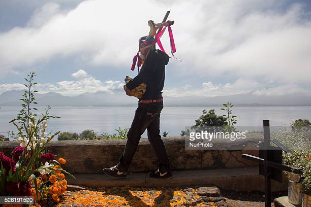 A man walks carrying the image of Jesus Christ in the cemetery of Janitzio on November 1 2015