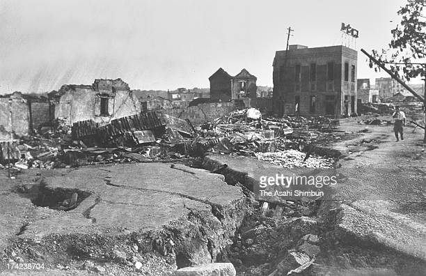A man walks destoyed Bentenbashi Street after the Great Kanto Earthquake in September 1923 in Yokohama Kanagawa Japan The estimated Magnitude 79...