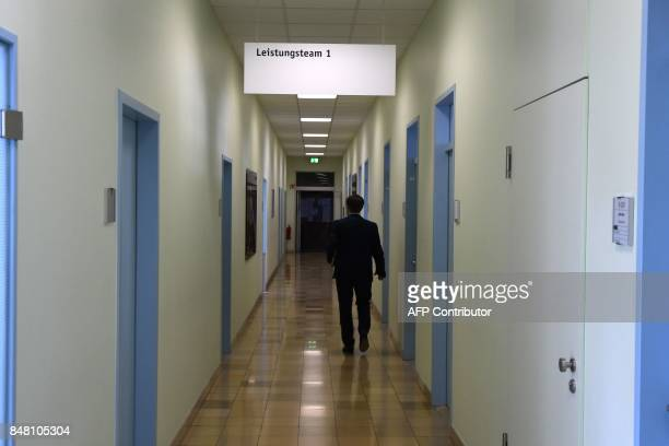 A man walks down a hallway at a Jobcenter in DuesseldorfMitte western Germany on August 25 2017 The number of people out of work has halved in...