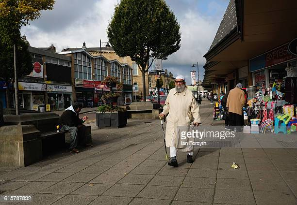 A man walks down a street as voting takes place in the Batley and Spen byelection on October 20 2016 in Batley United Kingdom The byelection in the...