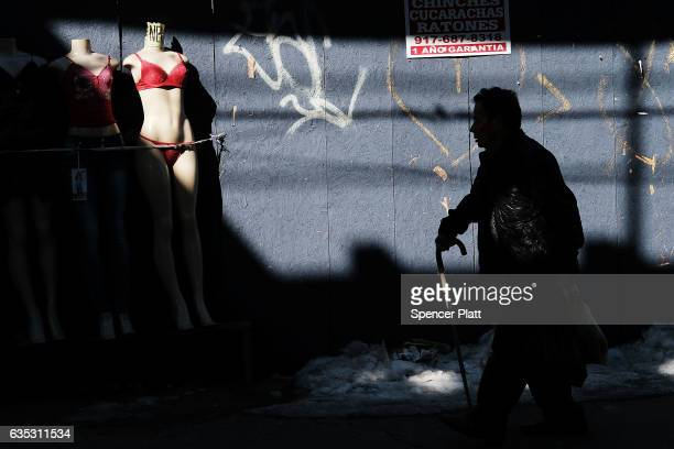 A man walks down a street in the Jackson Heights neighborhood with a large Latino immigrant population on February 14 2017 in the Queens borough of...
