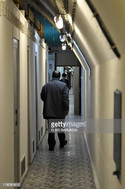 A man walks down a tunnel in the nuclear shelter exYugoslavia's iconic communist leader Josip Broz Tito in Konjic on May 11 2011 Embedded deep inside...