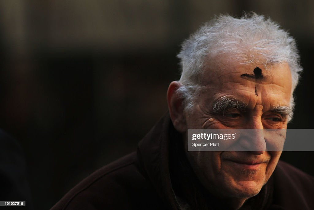 A man walks down Broadway with a cross of black ashes on his forehead on Ash Wednesday on February 13, 2013 in New York City. Ash Wednesday marks the beginning of Lent, a 40-day period of pray and fasting for many Christians.