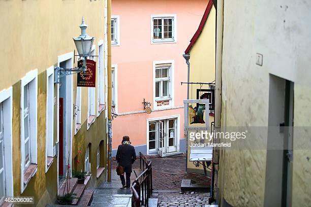 A man walks down Luhike jalg Street on March 3 2015 in Tallinn Estonia