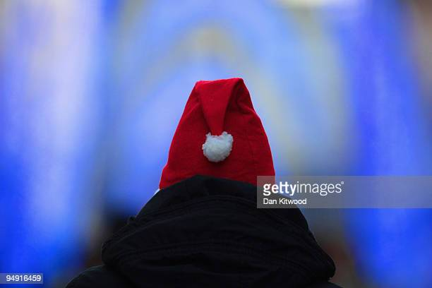 A man walks down Oxford Street wearing a Santa hat on December 19 2009 in London England The last weekend before Christmas is expected to be the...